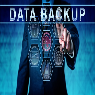 60987752 - business manager pushing data backup on an interactive virtual control screen interface. information technology concept for copying files or databases for future use in data recovery upon data loss.
